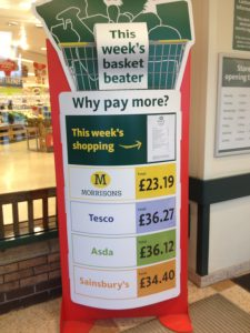 Morrisons totem - 'why pay more'